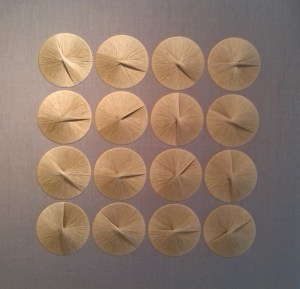 Embroidered 'sun-dials' for the Ford Foundation's wall.